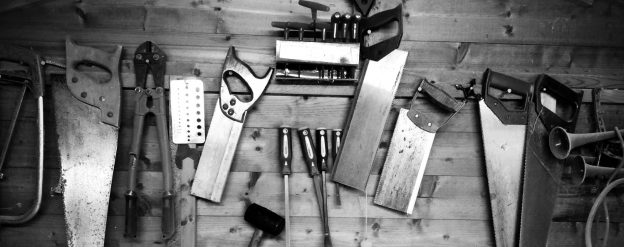 An array of carpenter's tools on the wall